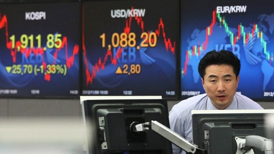 Nov. 8, 2012: A currency trader watches monitors at the foreign exchange dealing room of the Korea Exchange Bank headquarters in Seoul, South Korea.