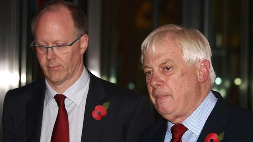 Nov. 10, 2012: The BBC Director General, George Entwistle, left, stands with the Chairman of the BBC Trust, Lord Chris Patten, as he announces his resignation as Director General outside New Broadcasting House in central London, after recent news program problems.