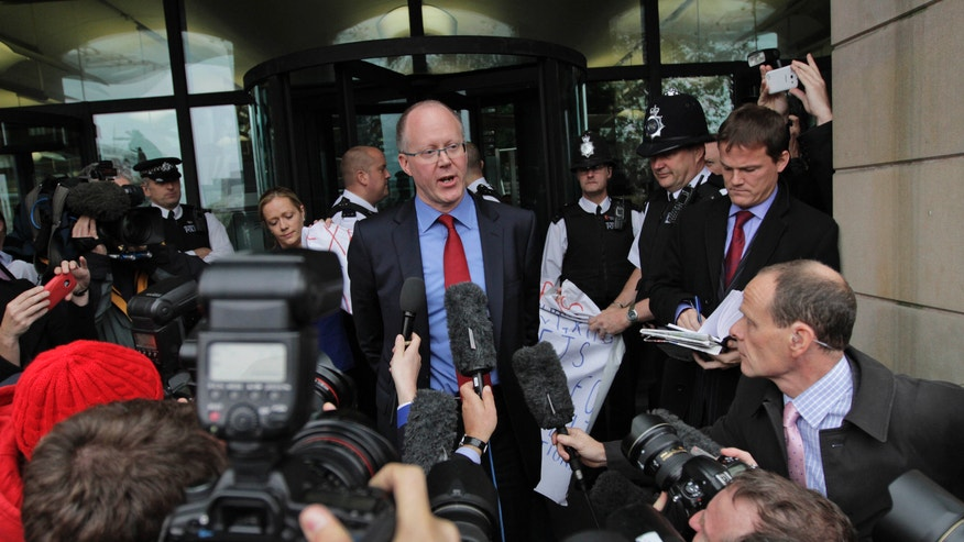 Oct. 23. 2012: George Entwistle, center, the British Broadcasting Corporation (BBC) Director General, talks to members of the media, as he departs Portcullis house in central London.