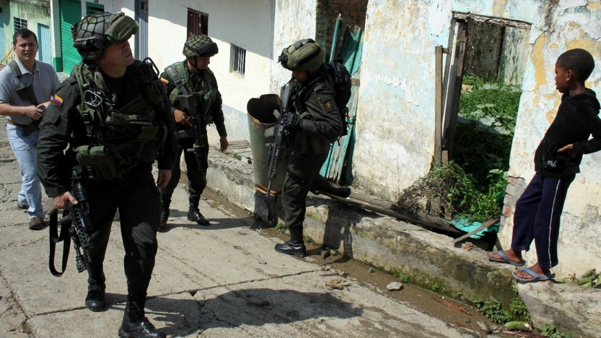 Nov. 12, 2012: Police officers inspect a house that was damaged by home made grenades thrown by alleged rebels of the Revolutionary Armed Forces of Colombia, or FARC, near a police station in Suarez, in Colombia's southern state of Cauca.