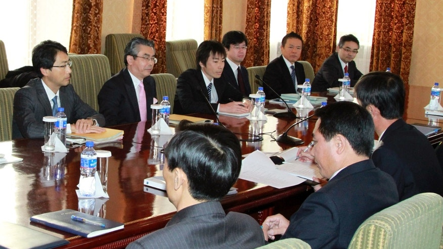 Nov. 15, 2012: Japanese chief negotiator Shinsuke Sugiyama, second left in background, director general of the Japanese Foreign Ministry's Asian and Oceanian Affairs Bureau, meets with North Korean counterpart in Ulan Bator, Mongolia.