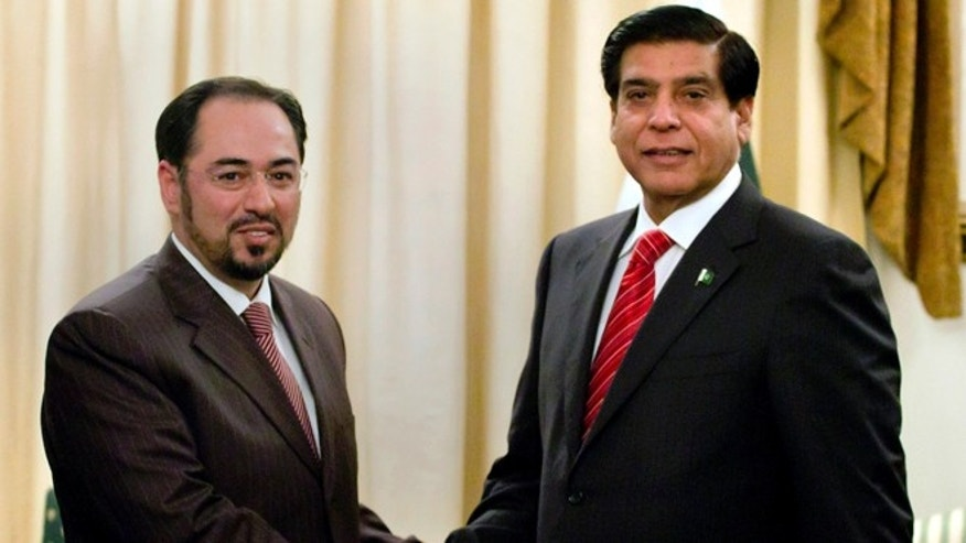 Nov. 12, 2012: Salahuddin Rabbani, left, head of Afghanistan High Peace Council, shakes hand with Pakistan's Prime Minister Raja Pervaiz Ashraf, for the benefit of the media prior to their meeting in Islamabad, Pakistan.