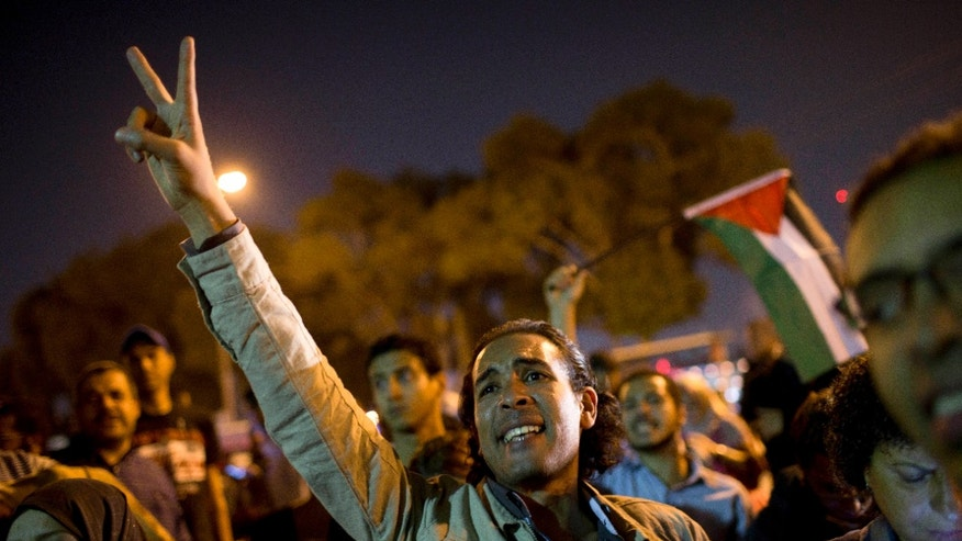 Nov. 14, 2012: Egyptians chant slogans against latest Israel airstrikes in Gaza during a protest in Cairo.