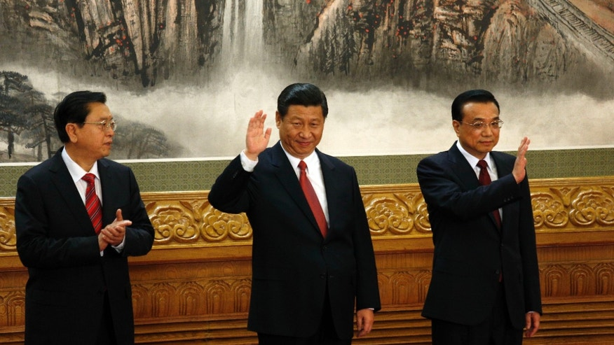 Nov. 15, 2012: Members of the new Politburo Standing Committee Zhang Dejiang, Xi Jinping, Li Keqiang meet journalists in Beijing's Great Hall of the People.