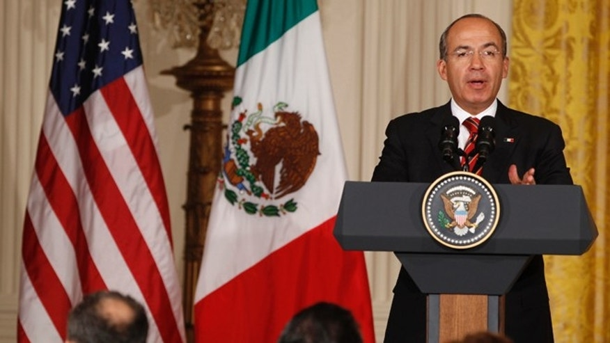 March 3, 2011: Mexico&#39&#x3b;s President Felipe Calderon answers a question during his joint press conference with President Obama at the White House.