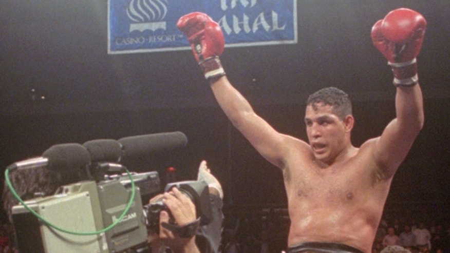 "FILE - This June 22, 1996, file photo shows Hector ""Macho"" Camacho being lifted into the air after his unanimous decision over Roberto Duran in an IBC middleweight title fight at the Trump Taj Mahal Casino Resort in Atlantic City, N.J."