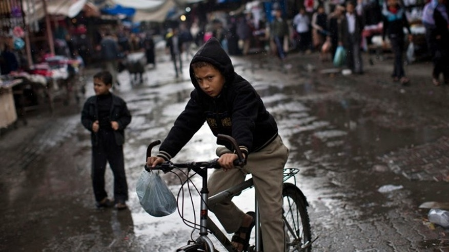 Nov. 23: A Palestinian rides a bike in the Jebaliya refugee camp, north Gaza Strip.