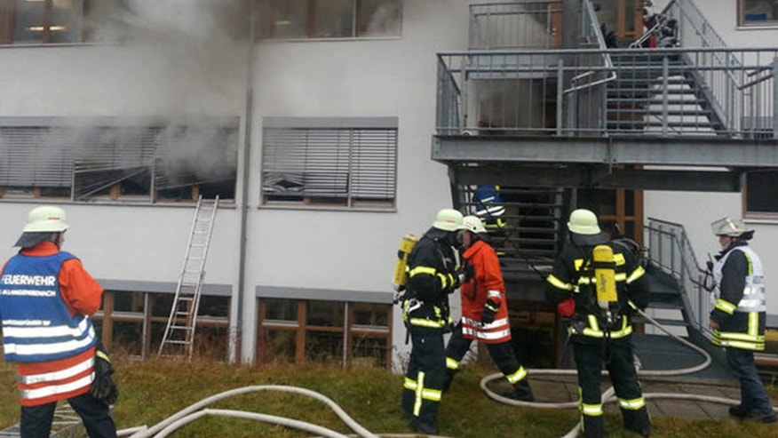 Nov. 26, 2012 - Firefighters try to extinguish flames in a workshop for disabled people in southwestern Germany.