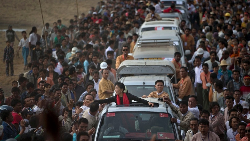 Nov. 30, 2012 - Opposition leader Aung San Suu Kyi reaches for supporters as she leaves after a public meeting close to Letpadaung mine in Monywa, northwestern Burma.