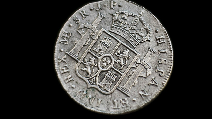 "Nov. 30, 2012- A silver coin from the shipwreck of an 1804 galleon ""Nuestra Senora de las Mercedes"""