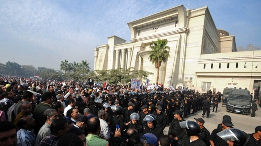 Dec. 2, 2012: Riot police form a cordon as several thousand supporters of Islamist President Mohammed Morsi surround the Supreme Constitutional Court on Sunday.