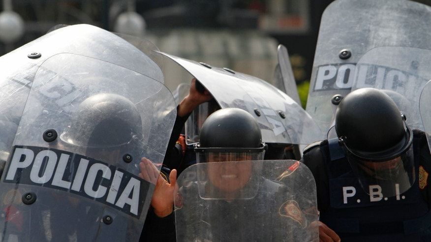 Dec. 1, 2012: Riot police take position in downtown Mexico City.  Protests against Mexico's newly sworn-in President Enrique Pena Nieto began early Saturday morning with violent confrontations in the streets and protest speeches from opposition parties inside the congress where Pena Nieto formally took the oath of office.