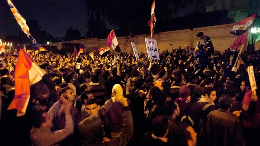 Dec. 4, 2012: Egyptian protesters chant anti Muslim Brotherhood slogans during a demonstration in front of the presidential palace in Cairo, Egypt.