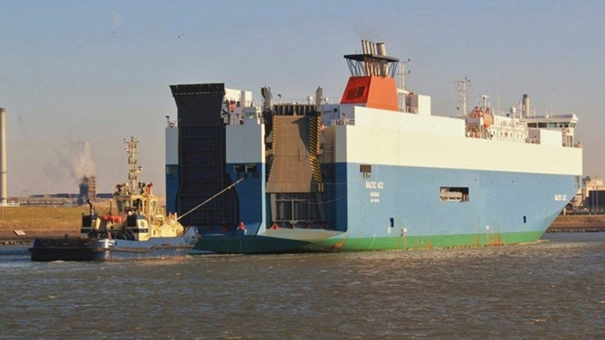 In this photograph released by Scheepvaartnieuws.blogspot.nl the Baltic Ace cargo ship is seen in IJmuiden, Netherlands, 2012.