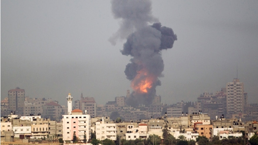 Nov. 17, 2012: Explosion and smoke rise following an Israeli strike in Gaza, seen from the Israel Gaza Border, southern Israel.