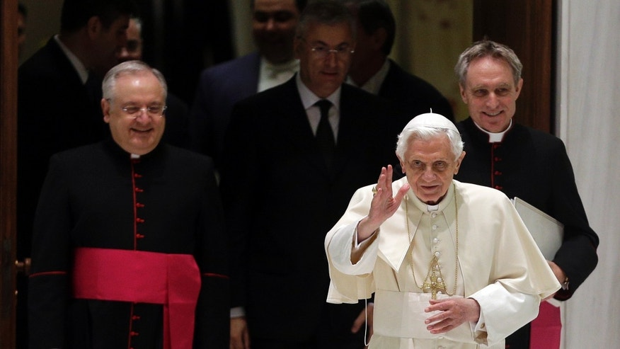 Dec. 5, 2012 - Pope Benedict XVI arrives for his weekly general audience followed by his personal secretary Georg Gaenswein, background right, and father Leonardo Sapienza, regent of the Prefecture of the Pontifical Household.