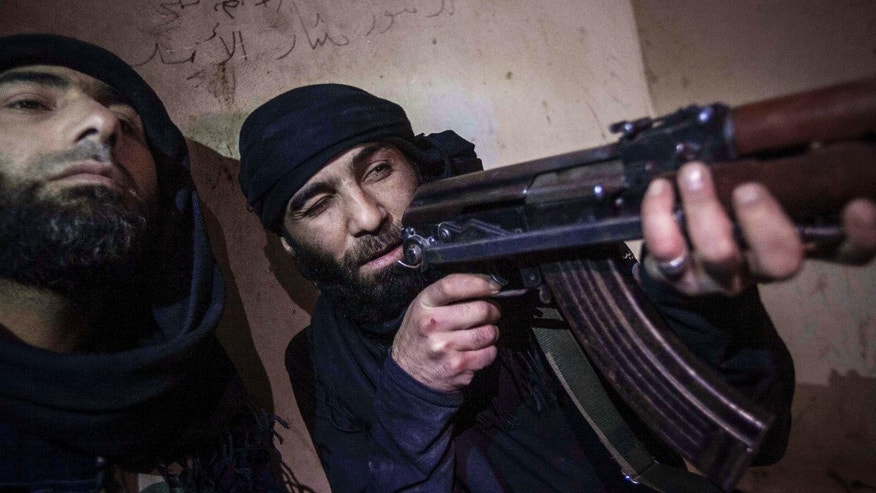 Dec. 5, 2012 - Free Syrian Army fighter aims his weapon during heavy clashes with government forces in Aleppo, Syria.