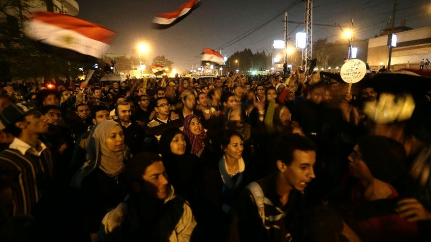 Dec. 6, 2012 - Egyptian protesters chant anti Muslim Brotherhood and Egyptian President Morsi slogans outside the presidential palace in Cairo, Egypt.