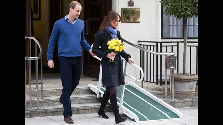 Dec. 6, 2012: Britain's Prince William stand next to his wife Kate, Duchess of Cambridge as she leaves the King Edward VII hospital in central London. Prince William and his wife Kate are expecting their first child, and the Duchess of Cambridge was admitted to hospital suffering from a severe form of morning sickness in the early stages of her pregnancy.