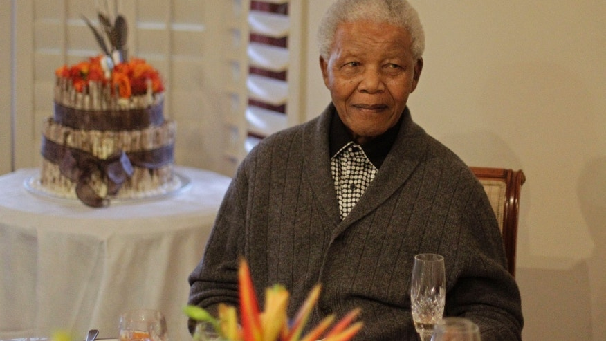 "July 18, 2012: File photo, former South African President Nelson Mandela as he celebrates his birthday with family in Qunu, South Africa. South African President Jacob Zuma says that former President Nelson Mandela has been admitted to hospital in Pretoria to undergo tests. Zuma issued a statement Saturday, Dec. 8, 2012 saying that Mandela is ""doing well and there is no cause for alarm."""