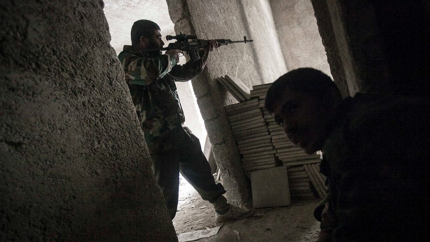 Dec 7, 2012 - Rebel fighter in Aleppo, Syria.