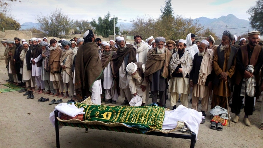 Dec. 10, 2012 - Afghan relatives & villagers prepare to offer funeral prayers over the body of Najia Sediqi, head of the women's affairs department in Laghman, east of Kabul, Afghanistan.
