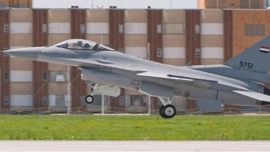Turmoil in Egypt isn't stopping a shipment of 20 F-16 fighter jets, including this one - already emblazoned with Egypt's flag. (Courtesy: Carl Richards)