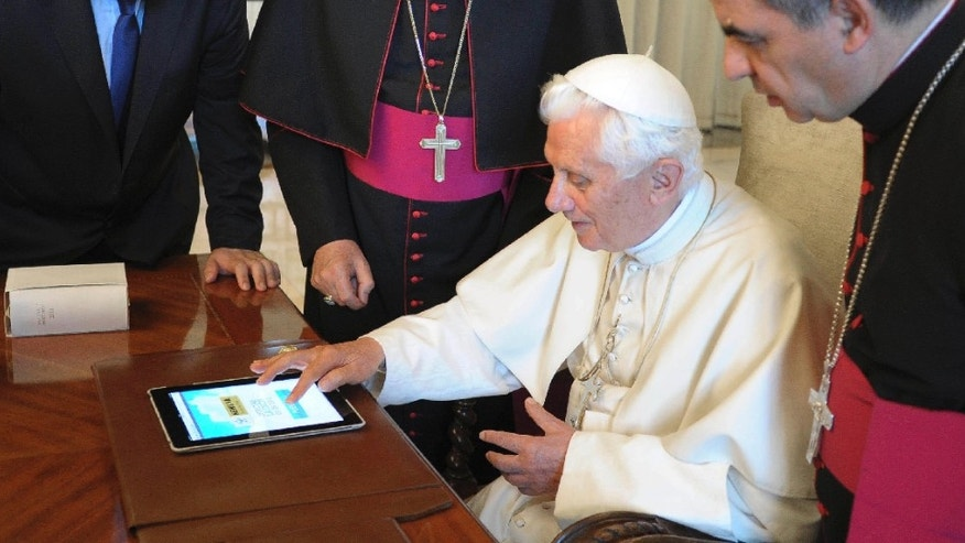FILE - In this June 28, 2011 file photo, Pope Benedict XVI touches a touchpad to send a tweet for the launch of the Vatican news information portal &quot&#x3b;www.news.va&quot&#x3b;, at the Vatican. The Vatican said Monday, Dec. 3, 2012, that Pope Benedict XVI will start tweeting in six languages from his own personal handle (at)Pontifex, on Dec. 12. The pontiff will be using a question and answer format in his first Tweet, focusing on answering questions about faith â in 140 characters. (AP Photo/Osservatore Romano, File) EDITORIAL USE ONLY