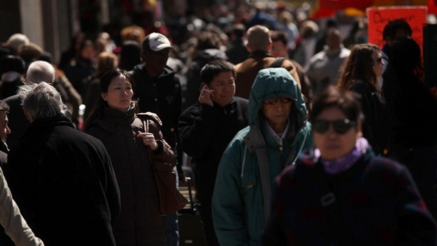 NEW YORK, NY - MARCH 25: Pedestrians walk down a city street on March 25, 2011 in New York City. According to the 2010 census count released yesterday, New York City's population reached 8.175 million, lower than the 8.4 million that city officials expected the number to be. New York City Mayor Michael Bloomberg, along with other city politicians, has challenged the bureau's findings and may take the issue to court. Among the other census findings are that the number of black New Yorkers has declined by 5 percent since 2000 and that the number of Asians increased by 32 percent.  (Photo by Spencer Platt/Getty Images)