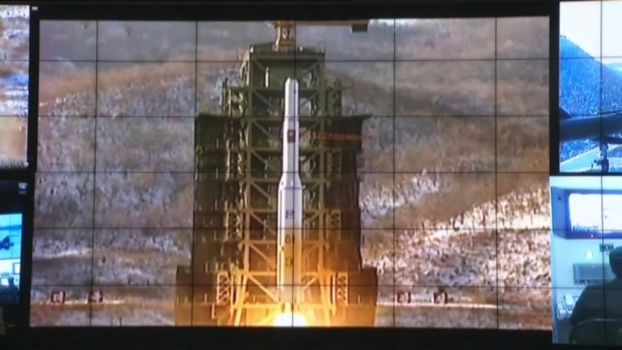 Dec. 12, 2012: This still frame made of video shows a display of the Unha-3 rocket launch at North Korea's space agency's General Launch Command Center on the outskirts of Pyongyang.