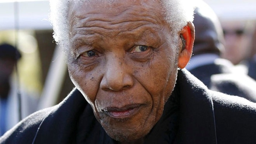 June 17, 2010: In this file photo, former South African President, Nelson Mandela leaves the chapel after attending the funeral of his great-granddaughter Zenani Mandela in Johannesburg, South Africa.