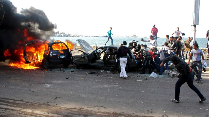 Dec. 14, 2012 -Cars burn during clashes between supporters and opponents of President Mohammed Morsi in Alexandria, Egypt.