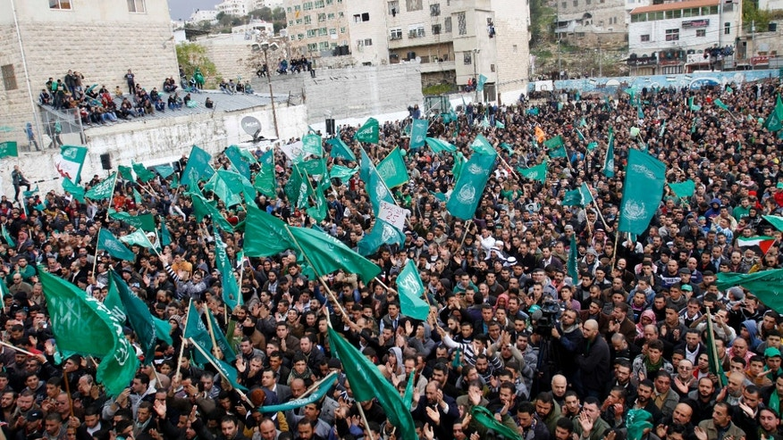 Dec. 14, 2012 - Palestinian supporters of Hamas gather during a rally to celebrate the 25th anniversary of the militant group, in the West Bank city of Hebron.