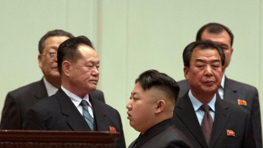 North Korean leader Kim Jong Un, center, leaves after attending a national meeting of top party and military officials on the eve of the first anniversary of the death of his late father Kim Jong Il in Pyongyang, North Korea, Sunday, Dec. 16, 2012. (AP Photo/Ng Han Guan)
