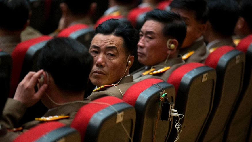 North Korean military officers listen with earphones during a national meeting of top party and military officials on the eve of Kim's first death anniversary in Pyongyang, North Korea, Sunday, Dec. 16, 2012. (AP Photo/Ng Han Guan)