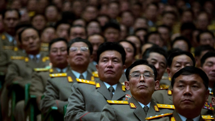 North Korean military officers attend a national meeting of top party and military officials on the eve of the first anniversary of the death of late leader Kim Jong Il in Pyongyang, North Korea, Sunday, Dec. 16, 2012. North Korea parlayed the success of last week's rocket launch to glorify leader Kim Jong Un and his late father on Sunday. (AP Photo/Ng Han Guan)