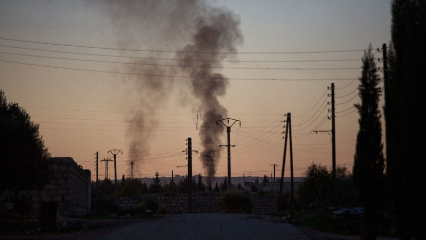 Smoke rises up after   intense fighting between Syrian Army and FSA in a military base in  Tal Sheen, Syria, Saturday, Dec 15, 2012 (AP Photo / Manu Brabo)