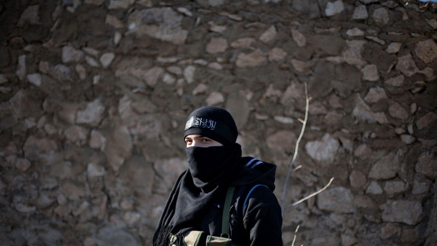 Syrian Army Fighter is seen on the frontline during the assault on a military base in Tal Sheen, Syria, Saturday, Dec 15, 2012. (AP Photo / Manu Brabo)
