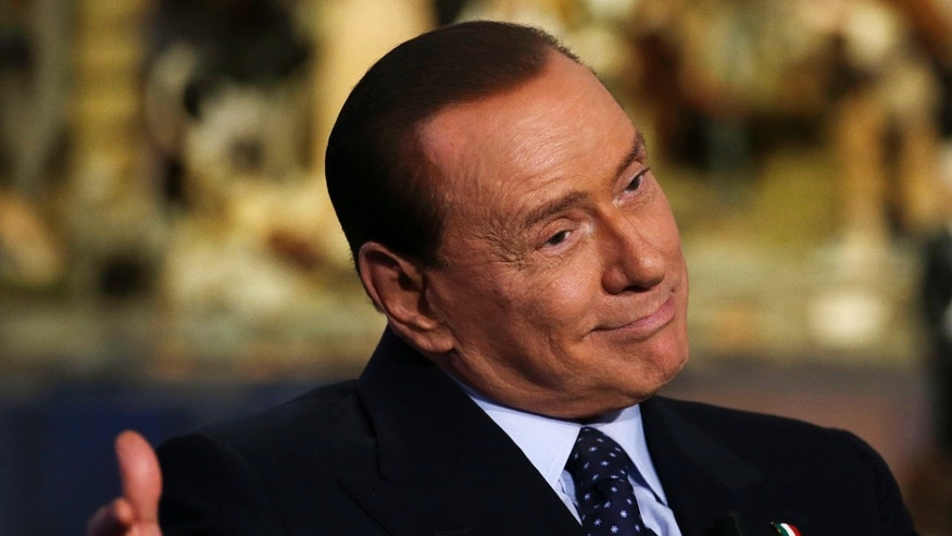 Dec. 18, 2012: Former Italian Premier and People of Freedom party Leader Silvio Berlusconi  gestures while attending the recording of RAI (Italian State Television) TV talk show &quot&#x3b;Porta a Porta&quot&#x3b;(Door to Door) hosted by journalist Bruno Vespa, in Rome.