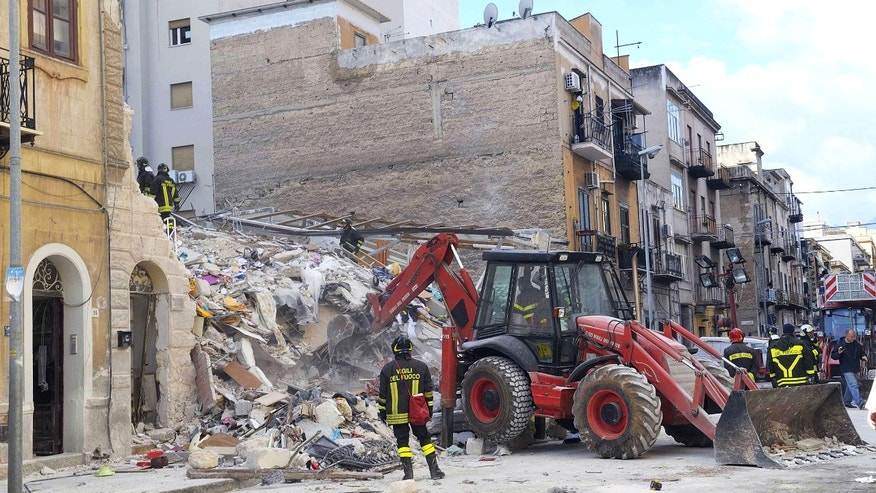 Dec. 18, 2012: Firefighters clear rubble after two buildings collapsed overnight, in Palermo, Italy.
