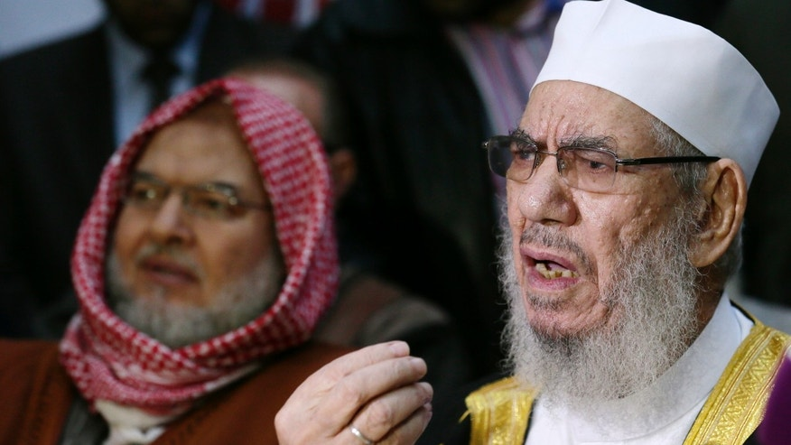 In this Sunday, Dec. 16, 2012 photo, 87-year old Sheik Ahmed el-Mahalawi, right, speaks during a press conference as Sheik Said Abdel-Azim, left, a leader of al-Dawa al-Salafiya, in Alexandria, Egypt. A politicized religious sermon by a prominent ultraconservative cleric set off angry protests, where sword-wielding supporters of Sheik el-Mahalawi clashed for hours with rock-throwing opponents. In an unimaginable twist, the cleric was locked up inside for over 12 hours during the battle, while opponents accused his supporters of detaining protesters and beating them inside the mosque. (AP Photo/Hassan Ammar)