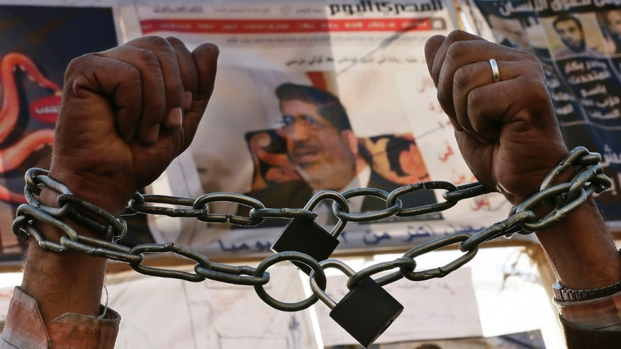 Dec. 17, 2012: A protester chains his hands during a protest in Tahrir Square in Cairo, Egypt, Monday, Dec. 17, 2012.