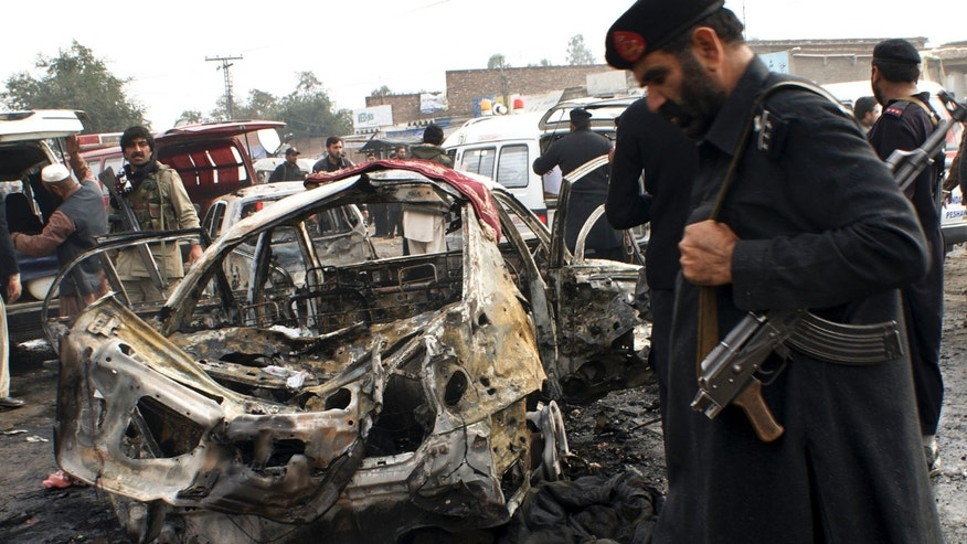 Dec. 17, 2012: Pakistani security personnel visit the site of bombing in Pakistani tribal area of Khyber.