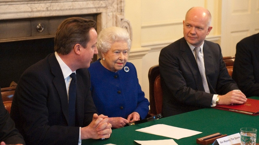 Dec. 18, 2012: Britain's Queen Elizabeth II, center,  attends a cabinet meeting sat between British Prime Minister David Cameron, left, and Foreign Secretary William Hague in 10 Downing Street in London.