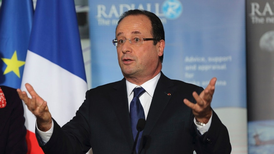French President Francois Hollande, delivers a speech as he visits the Radiall engineering and coaxial connectors plant in Chateau-Renault, central France, Monday, Dec. 17, 2012.  (AP Photo/Philippe Wojazer, Pool )