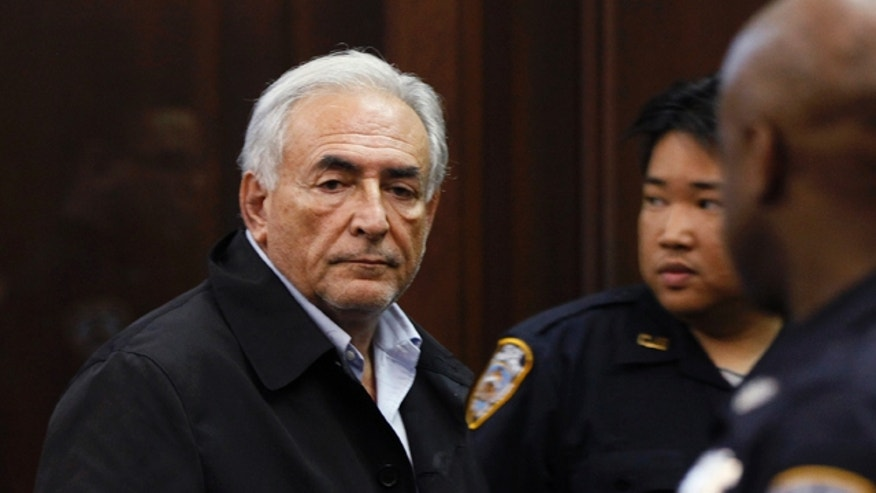 May 16: Dominique Strauss-Kahn, former head of the International Monetary Fund, leaves court after his arraignment in Manhattan Criminal Court for the alleged attack on a maid who went into his penthouse suite at a hotel near Times Square to clean it, in New York.