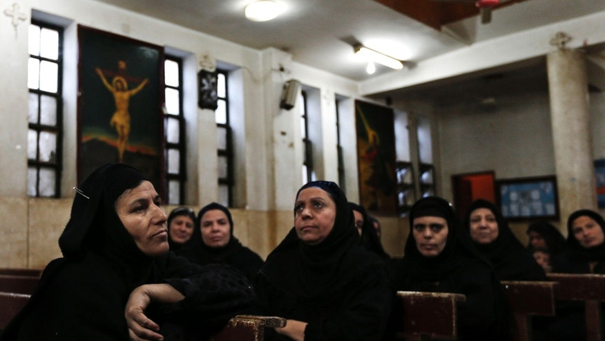 Dec. 18, 2012: Women attend a class in a church in the village of El-Aziyah near the city of Assiut, southern Egypt.
