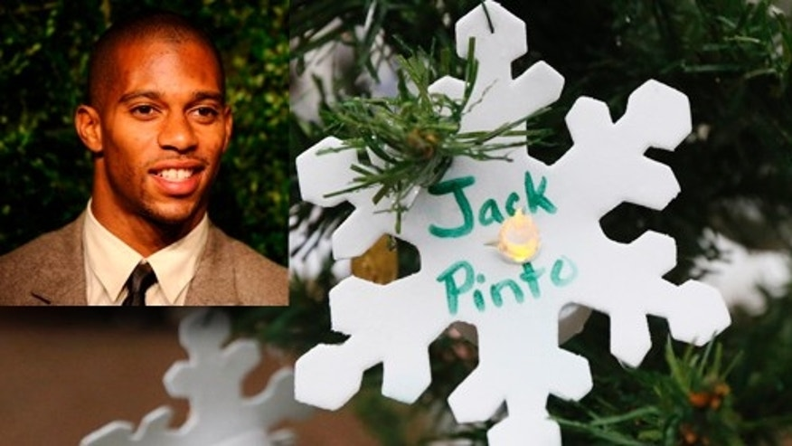 A snowflake ornament with the name of 6-year-old Jack Pinto hangs on a Christmas tree at a makeshift memorial in the Sandy Hook village of Newtown, Conn., Monday, Dec. 17, 2012, as the town mourns victims killed in Friday's school shooting. Pinto, who was killed Friday when gunman Adam Lanza opened fire inside the Sandy Hook Elementary School, will be buried Monday. (AP Photo/Julio Cortez)