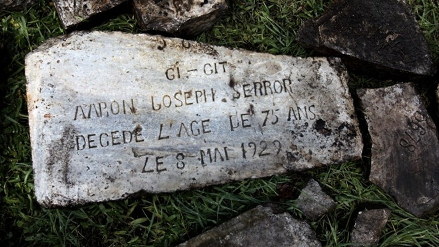 Dec. 20, 2012: Headstones destroyed during the Nazi occupation of Greece during World War II and recovered after they were found buried in a plot of land are seen on the ground at a Jewish cemetery, in the northern port city of Thessaloniki, Greece.
