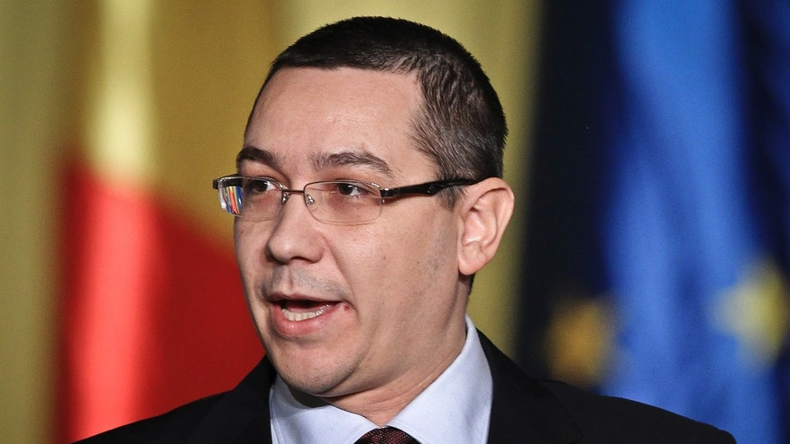 Romanian Prime Minister designate Victor Ponta addresses parliament during the presentation of his new cabinet in Bucharest, Romania, Friday, Dec. 21, 2012. Romania's parliament is expected to approve a center-left government putting ending fears that a bitter feud between the president and prime minister could lead to a political standoff. (AP Photo)